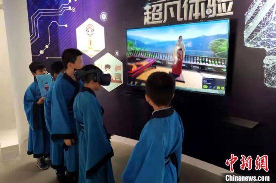 图为现场体验。陕西省文物局